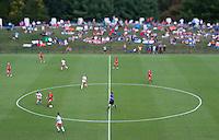 Lauren Berman (11) of Maryland carries the ball through the center circle at Klockner Stadium in Charlottesville, VA.  Virginia defeated Maryland, 1-0.