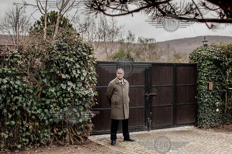 A man from a private security firm stands guard inside the home of a wealthy Istanbul resident that is being used as a set to film an episode of 'Oyle Bir Gecer Zaman Ki' (As Time Goes By). This is one of the most loved and most watched Turkish Soap Operas in the Middle East and North Africa.