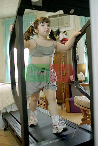 4 year old girl walking on treadmill set up in parents' room