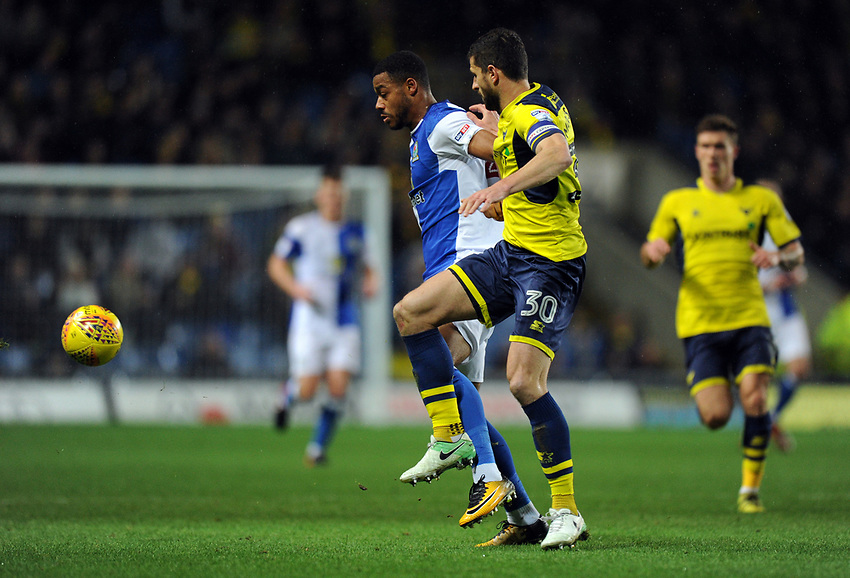 Blackburn Rovers' Joe Nuttall holds off the challenge from Oxford United's John Mousinho<br /> <br /> Photographer Ashley Western/CameraSport<br /> <br /> The EFL Sky Bet League One - Oxford United v Blackburn Rovers - Tuesday 21st November 2017 - Kassam Stadium - Oxford<br /> <br /> World Copyright &copy; 2017 CameraSport. All rights reserved. 43 Linden Ave. Countesthorpe. Leicester. England. LE8 5PG - Tel: +44 (0) 116 277 4147 - admin@camerasport.com - www.camerasport.com