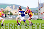 Thomas McGrath of Charlie Kerins feels the pressure from Sean Broderick of Duagh in the Division 7 Junior Final held last Friday evening in Castleisland.