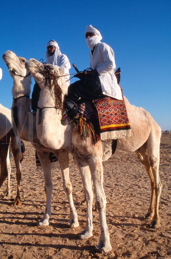 Tunisia Men on camels during the desert festival in Douz