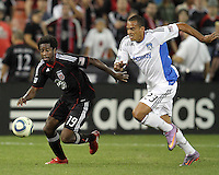 Clyde Simms #19 of D.C. United chases the ball with Eduardo #23 of the San Jose Earthquakes during an MLS match at RFK Stadium in Washington D.C. on October 9 2010. San Jose won 2-0.