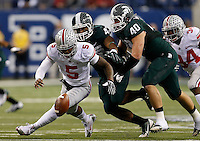Ohio State Buckeyes quarterback Braxton Miller (5) recovers his own fumble while being pursued by Michigan State Spartans linebacker Ed Davis (43) and Michigan State Spartans linebacker Max Bullough (40) during the first half of the Big Ten Championship football game at Lucas Oil Stadium in Indianapolis on Friday, December 7, 2013. (Columbus Dispatch photo by Jonathan Quilter)