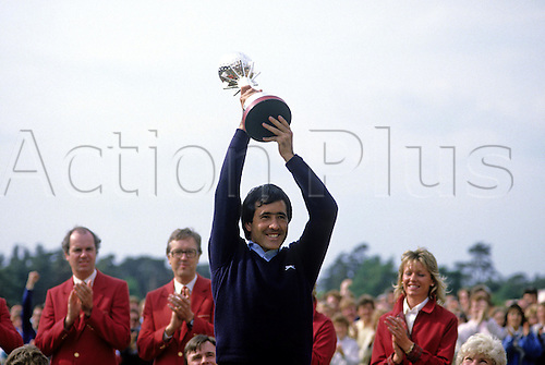 8 June 1986: Spanish golfer Seve Ballesteros (ESP) holds up the trophy after winning the Dunhill British Masters at Woburn, Bedfordshire. Photo: Tony Henshaw/Actionplus..860608 man men golf player winner champion cup celebration celebrating celebrate joy