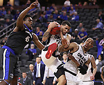 SIOUX FALLS, SD: MARCH 5: Marcus Tyus #23 of Omaha pulls down a rebound between teammate Tre'Shawn Thurman #15 and Brent Calhoun #45 of IPFW during the Summit League Basketball Championship on March 5, 2017 at the Denny Sanford Premier Center in Sioux Falls, SD. (Photo by Dick Carlson/Inertia)