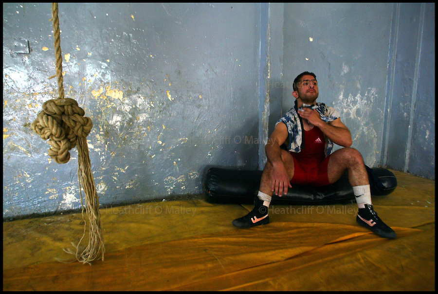 The Iraqi Olympic Wrestling Team train at the delapidated Aadamiyah Sports centre in Baghdad.Once brutalised by Saddam's son Uday Hussein who was previously head of the Olympic Committee in Iraq, the wrestlers now dream of a new life in the lucrative world of international sport.....Pic shows Amar Hussein,during a training session.