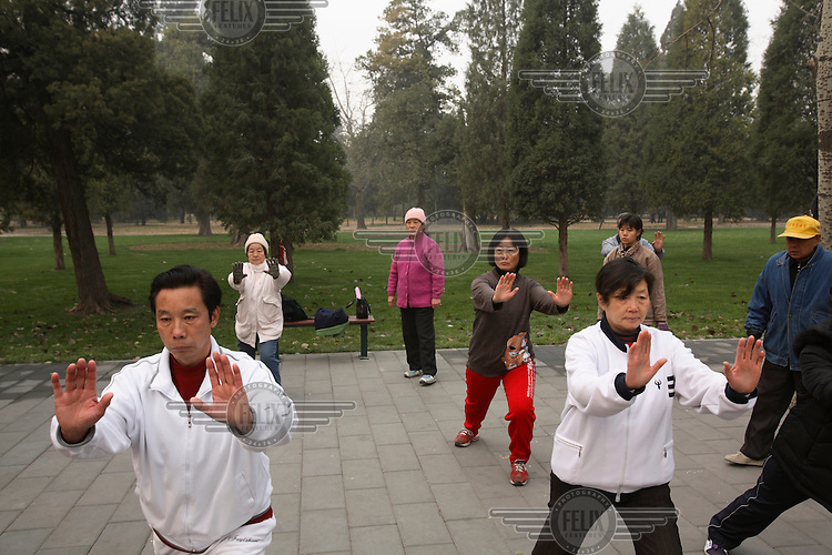 Men and women practising Tai Chi on a Sunday morning at the Temple of Heaven Park.  ....
