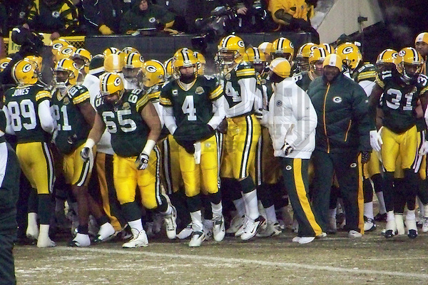 GREEN BAY - JANUARY 2008: Brett Favre #4 of the Green Bay Packers leads the team on to the field prior to the NFC Championship game on January 20, 2008 at Lambeau Field in Green Bay, Wisconsin. (Photo by Brad Krause)