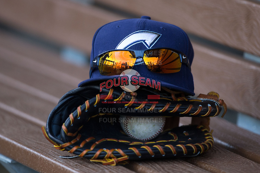 A Columbus Clippers hat sits on top of a glove in the visitor's dugout during the game against the Charlotte Knights at BB&T BallPark on May 27, 2015 in Charlotte, North Carolina.  The Clippers defeated the Knights 9-3.  (Brian Westerholt/Four Seam Images)
