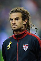 Kyle Beckerman of team USA stands for the national anthem prior to the friendly match France against USA at the Stade de France in Paris, France on November 11th, 2011.
