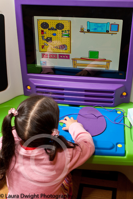 Education preschool 3-4 year ods girl using educational program on computer