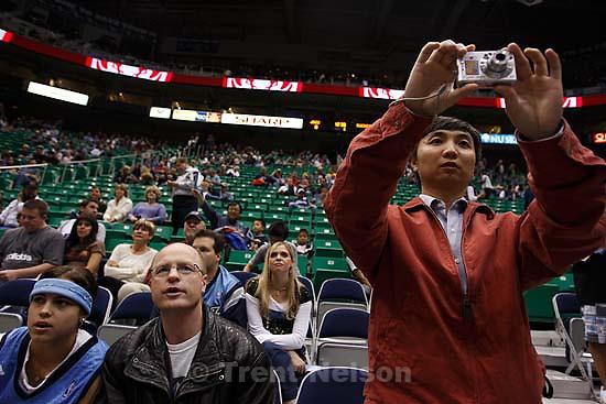 fans with camera. Salt Lake City - Utah Jazz vs. Houston Rockets. Scenes from the home season opener. 11.01.2007