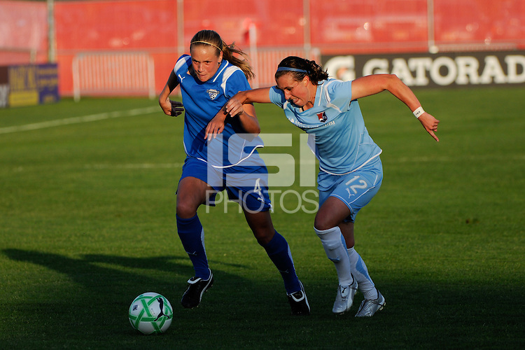 Stacy Bishop (4) of the Boston Breakers is defended by Meghan Schnur (12) of Sky Blue FC. Sky Blue FC defeated the Boston Breakers 2-1 during a Women's Professional Soccer match at Yurcak Field in Piscataway, NJ, on May 31, 2009.