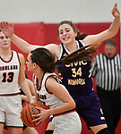 Civic Memorial forward Jackie Woefel (right) defends against Highland guard Megan Kronk. Highland played Civic Memorial in the Class 3A Effingham sectional championship game at Effingham High School in Effingham, Illinois on Thursday February 27, 2020. <br /> Tim Vizer/Special to STLhighschoolsports.com