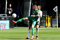 18th July 2020; Craven Cottage, London, England; English Championship Football, Fulham versus Sheffield Wednesday; Connor Wickham of Sheffield Wednesday competes for the ball with Michael Hector of Fulham