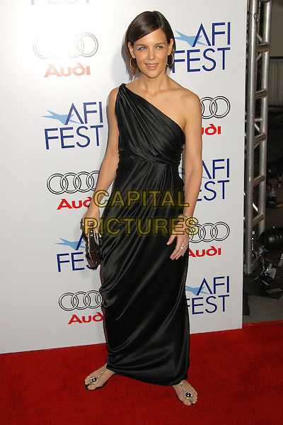 """KATIE HOLMES.AFI FEST 2007 Opening Night Gala Premiere of """"Lions for Lambs"""" at the Cinerama Dome, Hollywood, California, USA..November 1st, 2007.full length dress satin suit gold one shoulder black clutch purse flat shoes sandals.CAP/ADM/BP.©Byron Purvis/AdMedia/Capital Pictures."""