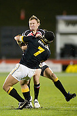 Kane Hancy gets taken in a strong tackle by Serge Lilo. Air New Zealand Cup rugby game between Counties Manukau Steelers & Wellington played at Mt Smart Stadium on the 31st August 2007. The Score was 13 all at halftime, with Wellington going on to win 33 - 18.