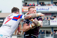 Picture by Allan McKenzie/SWpix.com - 08/04/2018 - Rugby League - Betfred Super League - Wakefield Trinity v Leeds Rhinos - The Mobile Rocket Stadium, Wakefield, England - Leeds's Brad Singleeton is tackled by Wakefield's Craig Huby.