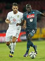 Panagiotis Tachtsidis  Kalidou Koulibaly   in action during the Italian Serie A soccer match between SSC Napoli and Verona  at San Paolo stadium in Naples, October 26, 2014