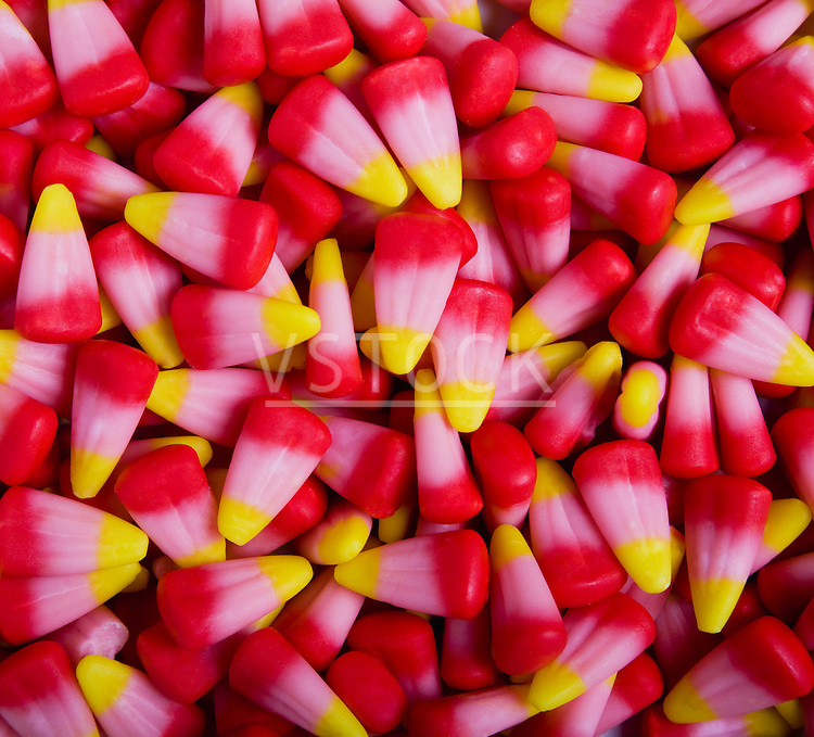 horizontal candy corn pattern still life background fall autumn holiday Halloween tradition traditional candies food sugar sugary sweet treat snack red pink yellow