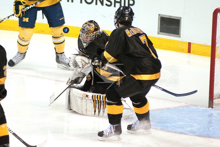 March 26,  2011                     The puck bounces off Colorado goalie Joe Howe (31) in the third period.  At right is Colorado defenseman Eamonn McDermott (7). The University of Michigan defeated Colorado College 2-1 in the championship game of the NCAA Division 1 Men's West Regional Hockey Tournament, on Saturday March 26, 2011 at the Scottrade Center in downtown St. Louis.