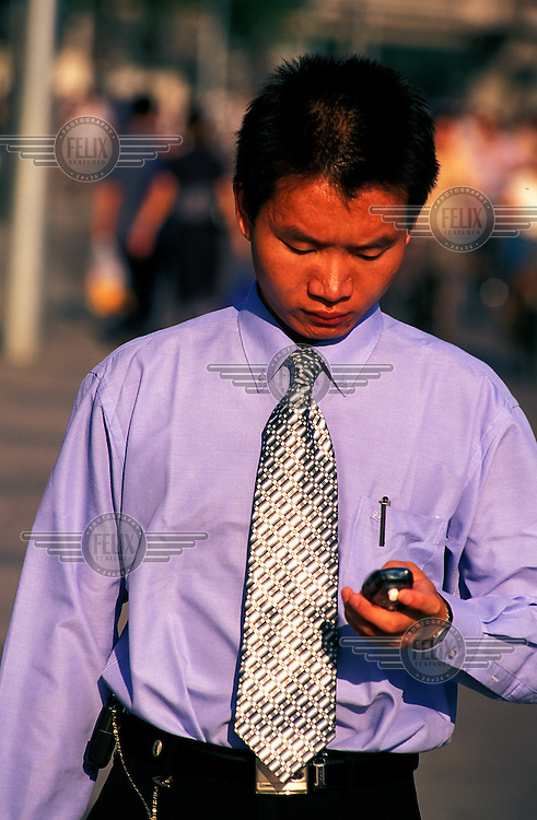 ©Chris Stowers/Panos Pictures..Man with mobile phone, Beijing.