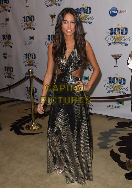 CHELSEA GILLIGAN.Night of 100 Stars - Arrivals held at the Beverly Hills Hotel, Beverly Hills, California, USA..March 7th, 2010.full length black gold bronze metallic lame shiny silver cur out away sides hand on hip dress.CAP/ADM/TC.©T. Conrad/AdMedia/Capital Pictures.