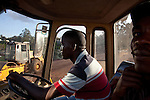 Samwel Kiarie, a heavy machinery opperator, on the  Chinese road building project at Museum Hill roundabout in Nairobi.