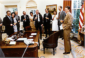 United States President Ronald Reagan, right, holds a victory glass of champagne to celebrate passage of the bipartisan tax cut bill with his staff in the Oval Office of the White House on Wednesday, July 29, 1981. From left to right: Richard Williamson, Elizabeth Dole, Dennis Thomas, Don Regan, Ann McLaughlin, Ed Meese, Vice President George H.W. Bush, Karna Small, David Gergen, and President Reagan. .Mandatory Credit: Michael Evans - White House via CNP