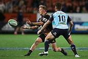 June 3rd 2017, FMG Stadium, Waikato, Hamilton, New Zealand; Super Rugby; Chiefs versus Waratahs;  Chiefs fullback Damian McKenzie passes ahead of Waratahs first five Bernard Foley during the Super Rugby rugby match