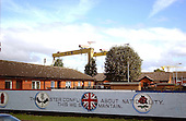 Belfast, Northern Ireland - August 14, 2005 -- Unionist / Loyalist mural on Lower Newtownards Road in Belfast, Northern Ireland on Sunday, August 14, 2005.  The two big cranes at the Harland and Wolff shipyard used for lifting ships out of the water can be seen in the background..Credit: Ron Sachs / CNP