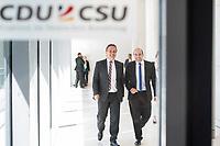 Hans-Peter Friedrich (links im Bild) und Florian Ossner (rechts), beide CSU, nach waehrend einer ausserordentlichen Sitzung der CDU/CSU-Fraktion nachdem es zwischen der CDU und der CSU zum Streit ueber den Umgang mit Fluechtlingen gab. Die Sitzung des Deutschen Bundestag wurde aufgrund dieses Streit auf Antrag der CDU/CSU-Fraktion fuer mehrere Stunden unterbrochen. Die Fraktionen von CDU und CSU tagten getrennt.<br /> 14.6.2018, Berlin<br /> Copyright: Christian-Ditsch.de<br /> [Inhaltsveraendernde Manipulation des Fotos nur nach ausdruecklicher Genehmigung des Fotografen. Vereinbarungen ueber Abtretung von Persoenlichkeitsrechten/Model Release der abgebildeten Person/Personen liegen nicht vor. NO MODEL RELEASE! Nur fuer Redaktionelle Zwecke. Don't publish without copyright Christian-Ditsch.de, Veroeffentlichung nur mit Fotografennennung, sowie gegen Honorar, MwSt. und Beleg. Konto: I N G - D i B a, IBAN DE58500105175400192269, BIC INGDDEFFXXX, Kontakt: post@christian-ditsch.de<br /> Bei der Bearbeitung der Dateiinformationen darf die Urheberkennzeichnung in den EXIF- und  IPTC-Daten nicht entfernt werden, diese sind in digitalen Medien nach &szlig;95c UrhG rechtlich geschuetzt. Der Urhebervermerk wird gemaess &szlig;13 UrhG verlangt.]