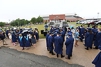 NWA Democrat-Gazette/J.T. WAMPLER Graduates gather in a drizzle Saturday May 20, 2017 before commencement ceremonies for Springdale Har-Ber High School held at Bud Walton Arena on the University of Arkansas campus in Fayetteville. This is the 12th commencement for the school and 651 seniors graduated.