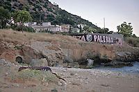 Vergine Maria beach was once very beautiful, now the water is polluted and the landscape ruined by illegal buildings.<br /> la spiaggia di Vergine Maria, una volta bella e incontaminata, adesso ha il mare inquinato e la spiaggia devastata dall'abusivismo.