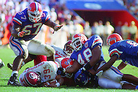 Stanley Pritchett (39), Dexter Daniles (48), Mark Campbell (67), University of Florida Gators defeat the University of South Carolina Gamecocks 48-17 at Ben Hill Griffin Stadium, Florida Field, Gainseville, Florida, November 12, 1994 . (Photo by Brian Cleary/www.bcpix.com)
