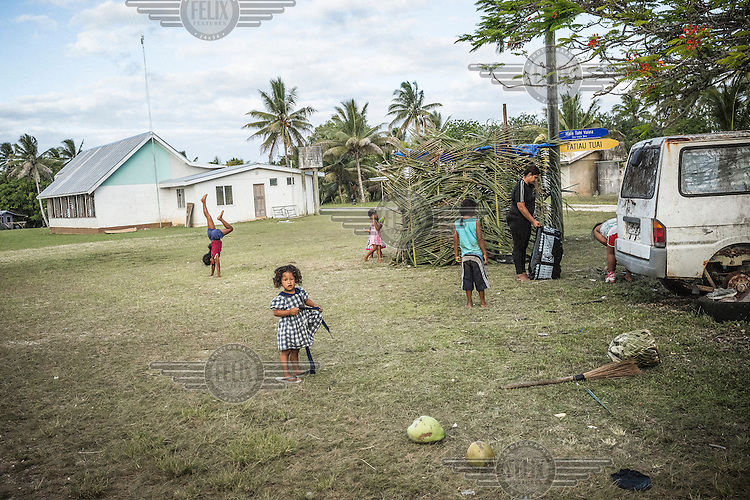 Tuvaluan children play in Vaiea village, Niue. Up to 100 Tuvaluans came across the Pacific to Niue. Many of them call themselves 'climate change refugees'. Overcrowding and threats causing by climate change have become a major push factor for Tuvaluans.