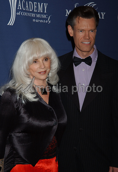 May 26, 2004; Las Vegas, NV, USA; Musician RANDY TRAVIS and wife LIBBY TRAVIS during the 39th Annual Academy of Country Music Awards held at Mandalay Bay Resort and Casino. Mandatory Credit: Photo by Laura Farr/AdMedia. (©) Copyright 2004 by Laura Farr