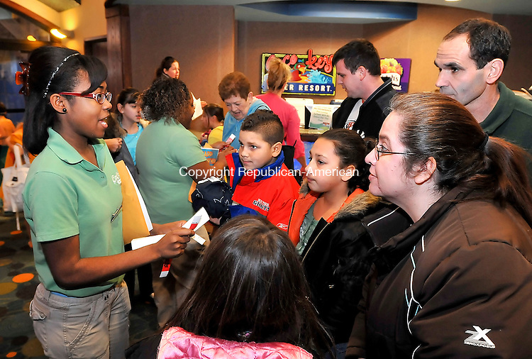 WATERBURY, CT- 29 JANUARY 2008 --012909S01--Tyashia Gordon, left, a Birthday Party Host at the CoCo Key Water Resort at the Holiday Inn in Waterbury, talks with the Santerre family of Southington as they arrive at the resort on Thursday for Allison Santerre's 9th birthday party. CoCo Key will be hosting a job fair next week in an effort to hire 40-50 new employees. On Thursday after the resort hosted at least three birthday party's as well as 400 girl scouts. <br /> Jim Shannon / Republican-American