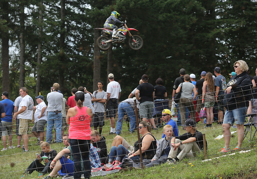 Families enjoy a themselves as motorcycles fly over-head in the 450cc race in the Washougal MX National in Washougal Saturday July 23, 2016. D(Photo by Natalie Behring/ for the The Columbian)