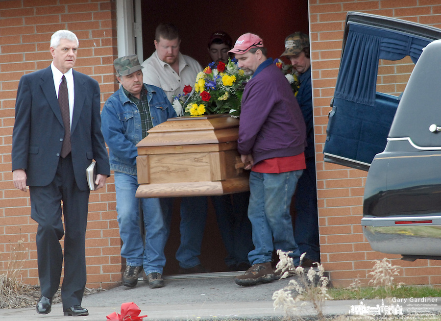 Pallbearers carry the casket for Sago miner Jesse Jones Sunday, Jan. 8, 2006, in Buckhannon, WV Jones is one of 12 miners killed in the Sago mine explosion. At right is Jones' brother, Owen Jones. (Gary Gardiner/EyePush Newsphotos)<br />