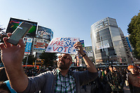 A man takes a selfie of himself holding a sign at the Vote Out the Scandal rally at Hachiko Square, Shibuya, Tokyo, Japan. Sunday November 5th 2017. Timed to coincide with President Trumps visit to Japan, About 120 Americans living in Japan and some local Japanese  protested together from 2pm to 4pm to encourage US citizens to register to vote in future elections and call on the US government to honour it responsibilities to the American people,.