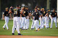 Pittsburgh Pirates coach Jeff Banister (28) watches team stretches during the teams first Spring Training practice on February 18, 2019 at Pirate City in Bradenton, Florida.  (Mike Janes/Four Seam Images)