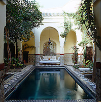 A pool lined in blue-and-white ceramic tiles creates an oasis of calm in the central courtyard of Riad Edward situated in the Marrakech Medina