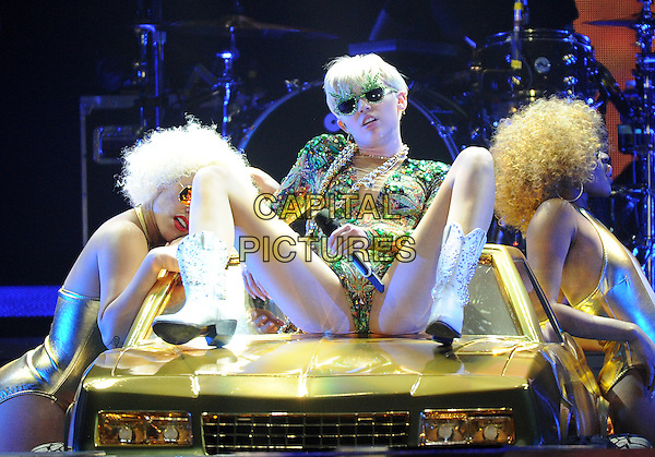 LAS VEGAS, NV - MARCH 1: Miley Cyrus performs on her &quot;Bangerz Tour&quot; at the MGM Grand Garden Arena in Las Vegas, Nevada on March 1, 2014. <br /> CAP/MPI/PG<br /> &copy;PictureGroup/MediaPunch/Capital Pictures