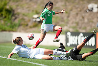 Abby Wambach tries to slip the ball past Mexico's Leticia Villalpando (2) and goalkeeper Pamela Tajonar..USA 3-0 over Mexico in San Diego, California, Sunday, March 28, 2010.