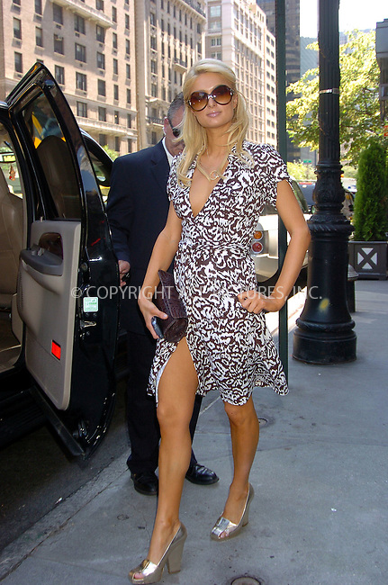 WWW.ACEPIXS.COM . . . . .  ....June 9, 2006, New York City....Paris Hilton poses with fans as she arrives at her hotel.....Please byline: AJ Sokalner - ACEPIXS.COM..... *** ***..Ace Pictures, Inc:  ..(212) 243-8787 or (646) 769 0430..e-mail: info@acepixs.com..web: http://www.acepixs.com