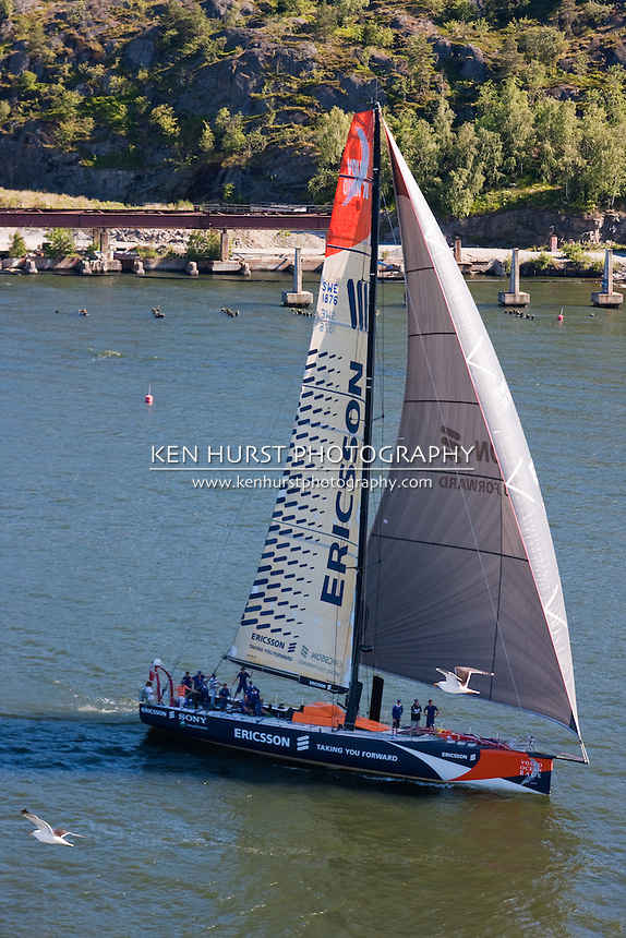 Racing team on a Sony Ericsson Volvo Ocean Race yacht in Stockholm harbor in 2009 waving to spectators.