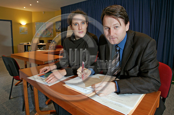 BRUSSELS - BELGIUM -10 JANUARY 2007 -- Proposal of the EU-Commission on an integrated energy and climate change package. -- Paal FRISVOLD (Ri) and his colleague Claire CHEVALLIER from the Bellona Europe Office, a Norwegian environmental lobby group, going through the integrated energy and climate change proposal of the Commission, where they had influence on as consultants. --PHOTO: JUHA ROININEN / EUP-IMAGES
