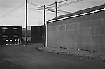 Alley way, assigned parking, and wires. Lewisburg, PA. 1973. File #73-139-7